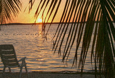 Saturday morning sunrise. Sunrise with chair at beach Royalty Free Stock Images