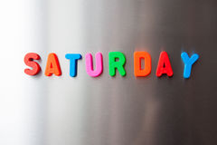 Saturday. The word `Saturday` with colorful letters on gray fridge royalty free stock image