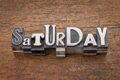 Saturday word in mixed vintage metal type Stock Photos
