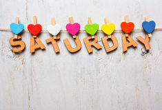 Saturday word from wooden letters on a white wooden background stock photo