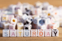 Saturday written in letter beads on wood background Royalty Free Stock Photography