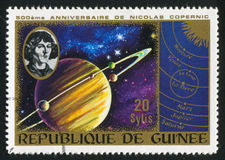 Saturn. GUINEA CIRCA 1973: stamp printed by Guinea, shows Saturn and heliocentric system, circa 1973 Royalty Free Stock Image