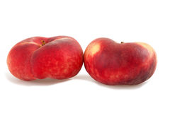 Saturn peach. Two saturn peach isolated on white Royalty Free Stock Photos