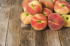 Saturn Peaches. On old wooden table Royalty Free Stock Images