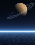 Saturn rising over a night time sea Royalty Free Stock Photos