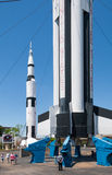 Saturn V rockets. A visitor to the Marshall Space Flight Center stands at the base of the Saturn V rocket Royalty Free Stock Photos