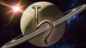 Saturn zodiac horoscope symbol and planet. 3D rendering. 3D rendering image of a brilliant gold Saturn zodiac horoscope symbol. An astrology sign on the Stock Image