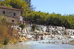Natural spa with waterfalls and hot springs at Saturnia thermal. SATURNIA, ITALY - JULY 26, 2017: Natural spa with waterfalls and hot springs at Saturnia thermal royalty free stock photos