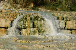 Saturnia Thermal Hot Springs with a Waterfall Stock Photos