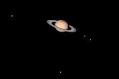 Saturnus en manen Stock Afbeeldingen