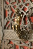 The Satyr on the door. Door handle in the shape of a satyr Royalty Free Stock Image