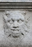 Satyr mask basrelief. Detailed view of an satyr mask basrelief Stock Images