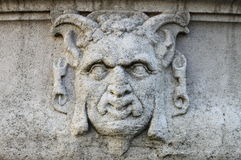 Satyr mask basrelief. Detailed view of an satyr mask basrelief Royalty Free Stock Photos