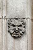 Satyr mask basrelief. Detailed view of an satyr mask basrelief Royalty Free Stock Image