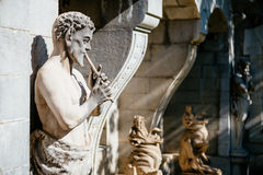 Satyr playing a pipe. Sculpture decoration Massandra Palace in Yalta, Crimea Stock Image