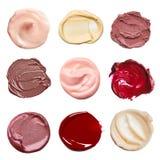 Satz Abstriche von den verschiedenen kosmetischen Produkten Stockbilder