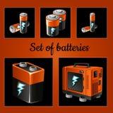 Satz Batterien auf einem braunen Hintergrund Lizenzfreie Stockbilder