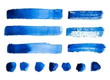 Satz blaue abstrakte Aquarellanschläge und -flecke lokalisiert Stockbild