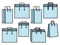 Satz blaue Einkaufstascheikonen Stockfotografie