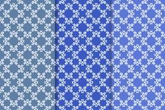 Satz Blumenverzierungen Blaue vertikale nahtlose Muster Lizenzfreie Stockfotografie