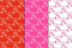 Satz Blumenverzierungen Rote pinkfarbene nahtlose Muster Lizenzfreies Stockbild
