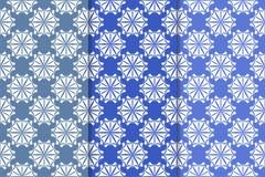 Satz Blumenverzierungen Vertikale blaue nahtlose Muster Stockfotografie