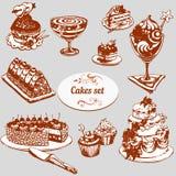 Satz Bonbons und Kuchen Stockfotografie