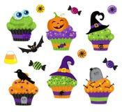 Satz bunte Halloween-Bonbons, kleiner Kuchen und Süßigkeitsikonen Lizenzfreie Stockfotos
