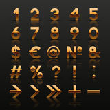 Satz dekorative goldene Zahlen und Symbole Stockfotografie