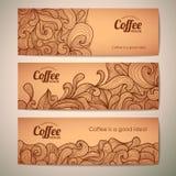 Satz dekorative Kaffeefahnen Stockfotos