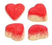 Satz der Süßigkeit von der weißen Schokolade in Form von Herzen Stockbilder