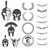 Satz der spartanischen Kriegerssturzhelme und -Gestaltungselemente für Emblem Stockfotografie