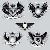 Satz des geflügelten Schildes der Wappenkunde Stockfoto