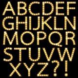 Satz des goldenen Glühlampe-Alphabetes Broadways Stockbild