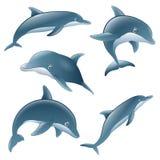 Satz des Karikaturdelphins Lizenzfreie Stockfotografie