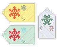 Satz des Weihnachtsgeschenks etikettiert in den verschiedenen Farben mit Schneeflocken Lizenzfreie Stockfotos