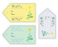 Satz des Weihnachtsgeschenks etikettiert in den verschiedenen Farben mit stilisiertem Weihnachtsbaum Stockfoto