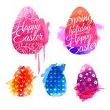 Satz farbige Eier mit Aquarellbeschaffenheiten Stockfotografie