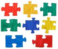 Satz farbige gemalte Puzzlespielstücke Lizenzfreies Stockbild