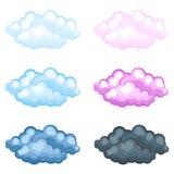Satz flaumige Wolken der unterschiedlichen lustigen Karikatur Stockfotos