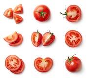 Satz frische ganze und geschnittene Tomaten stockfotografie