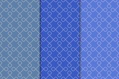 Satz geometrische Verzierungen Blaue nahtlose Muster Stockfotografie