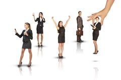 Satz Geschäftsleute mit der riesigen Hand Lizenzfreies Stockfoto