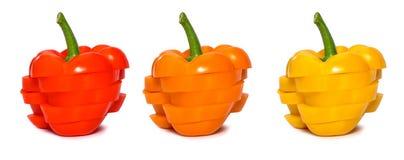 Satz geschnittener Paprika lokalisiert Roter, gelber und orange spanischer Pfeffer Lizenzfreies Stockbild