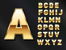 Satz glänzende goldene Buchstaben Stockfotografie