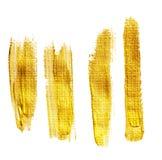 Satz goldene Bürstenanschläge Stockbilder