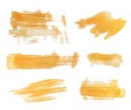 Satz goldene Farbenanschläge Lizenzfreie Stockfotos