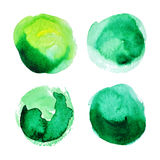 Satz grüne Watercolourflecke Stockfotografie