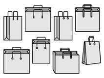 Satz graue Einkaufstaschen Stockbilder