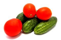 Satz Gurken und Tomaten Stockbild